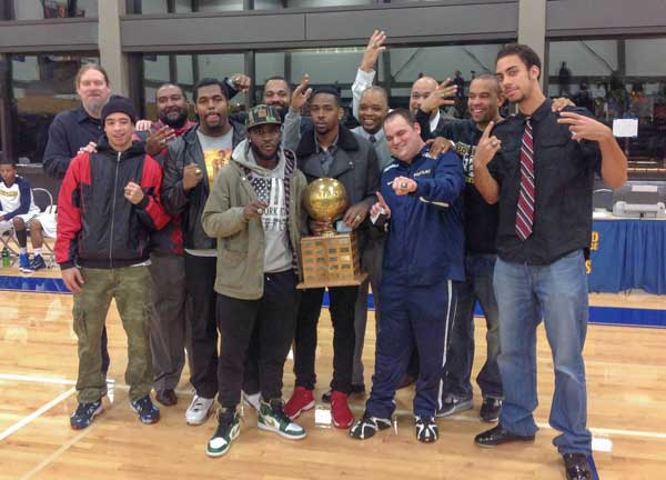 PCC's mens basketball team celebrating a win