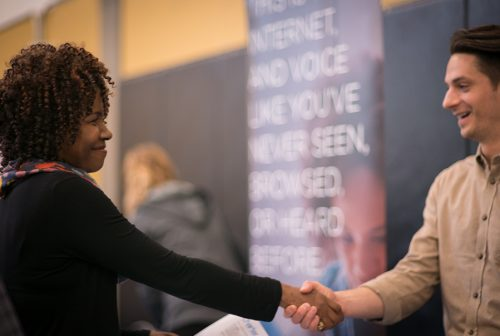 Employer and Job Seeker shaking hands at the PCC Spring Job Fair