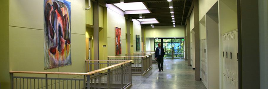 Indoor hallway with artwork and professor