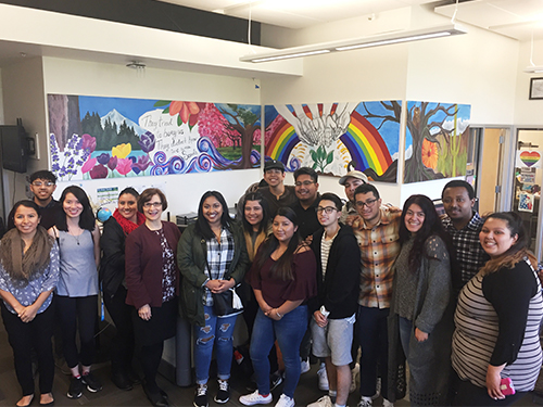 Diverse group of students posing together in the Rock Creek Multicultural Center