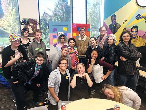 Diverse group of students posing together in the Rock Creek Queer Resource Center