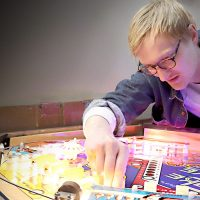 Luke Christensen working on a pinball machine