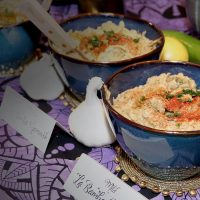 Close-up of delicious Ganoush dishes on a colorful table