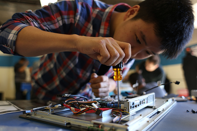 Student working on computer parts