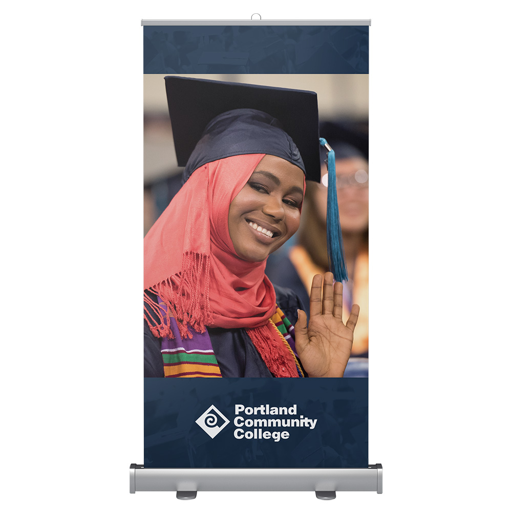 Wide banner stand with student at graduation
