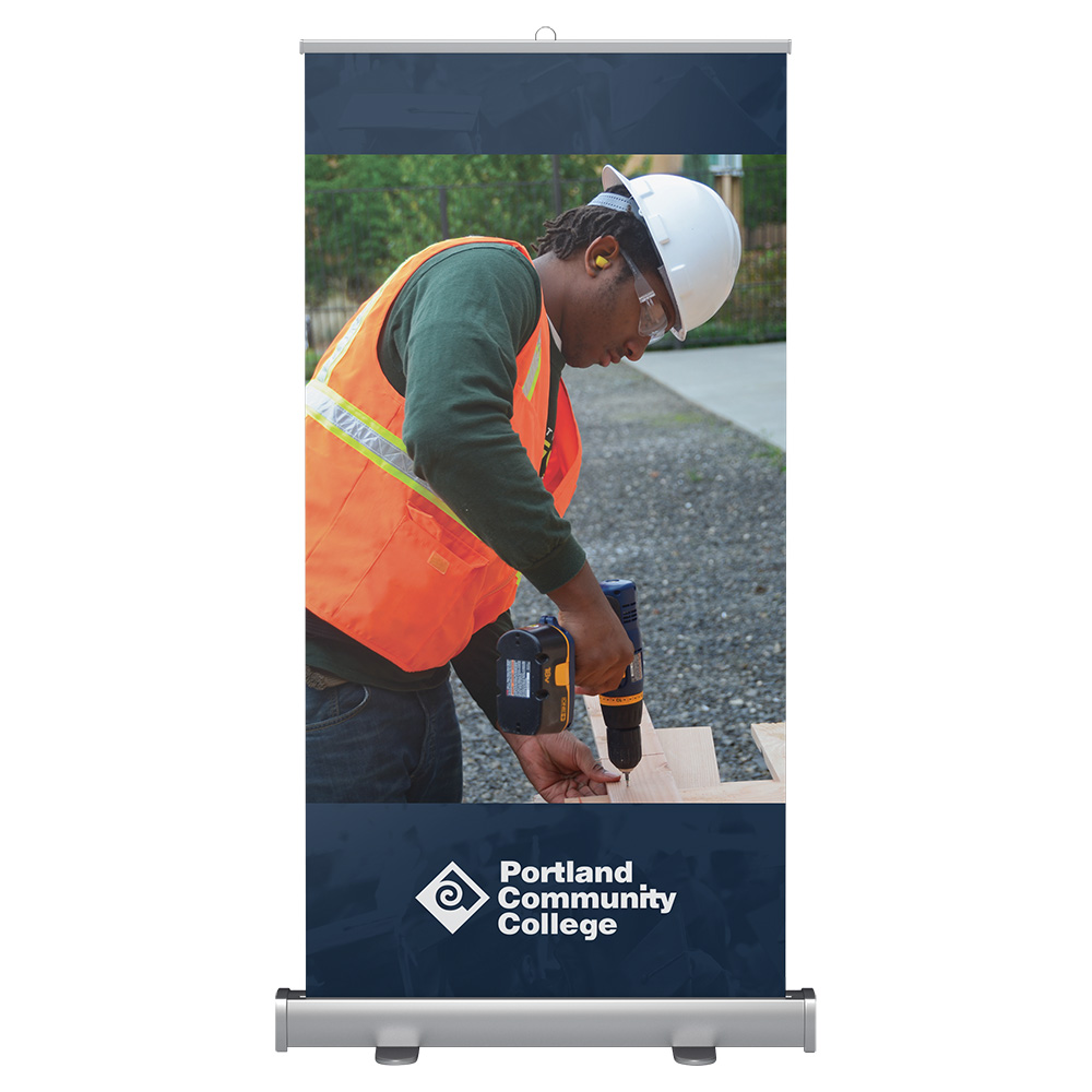 Wide banner stand with construction student at the job site