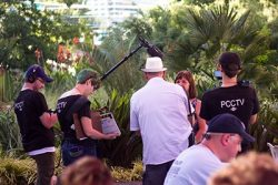 Film crew interviewing during an interview