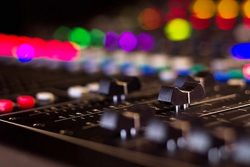 Close-up of soundboard audio equipment
