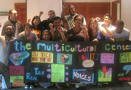 Students holding a Multicultural Center banner
