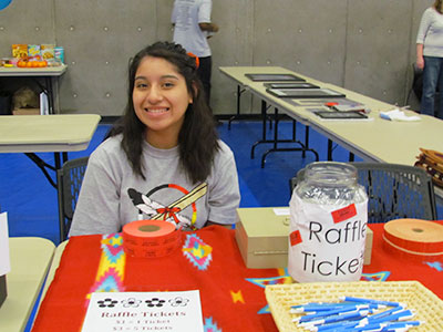 Student working at a raffle table