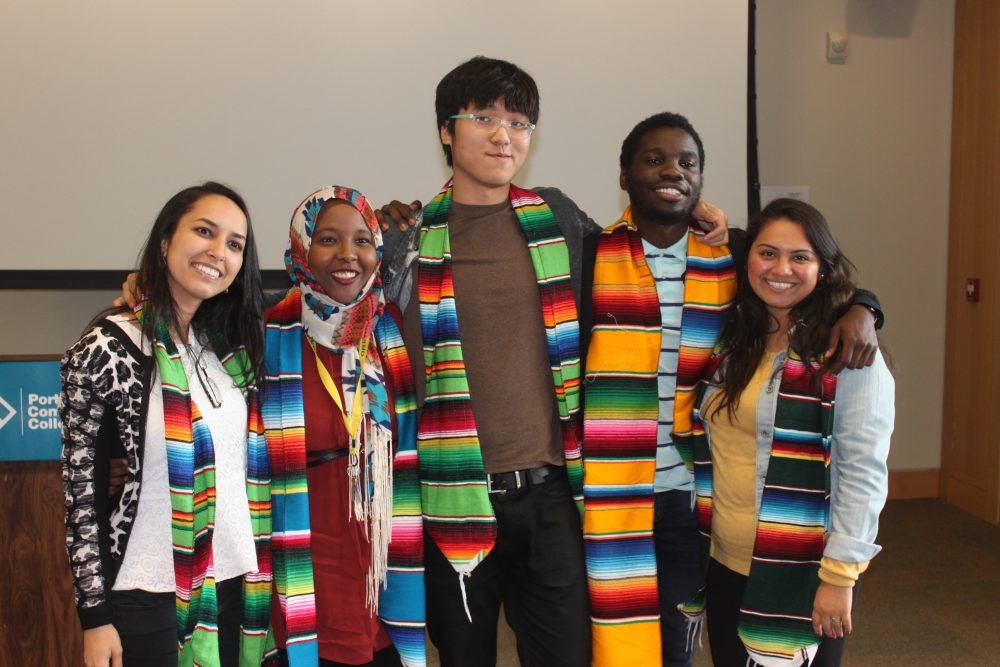 Students wearing matching scarves