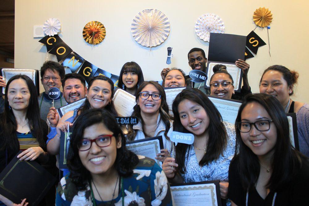 Students at an MC graduation event