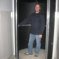 Gary Sutton, Sylvania's bond program manager, shows off the newly renovated photography lab which includes a spinning door to the dark room.
