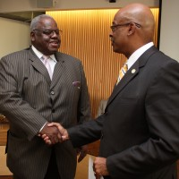 Harold Williams, left, is congratulated by PCC President Preston Pulliams on Williams' winning the Pacific Region Trustee Leadership Award in 2010