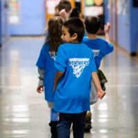 Kids wear Panther shirts provided by PCC.