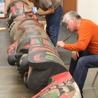Award-winning Kwagiulth Native Artist Richard Hunt (foreground) and Sylvania's Division Dean of Visual & Performing Arts Gene Flores spent two days in November fixing holes, rot damage and repainting the totem pole with bright colors to restore it to its previous glory.