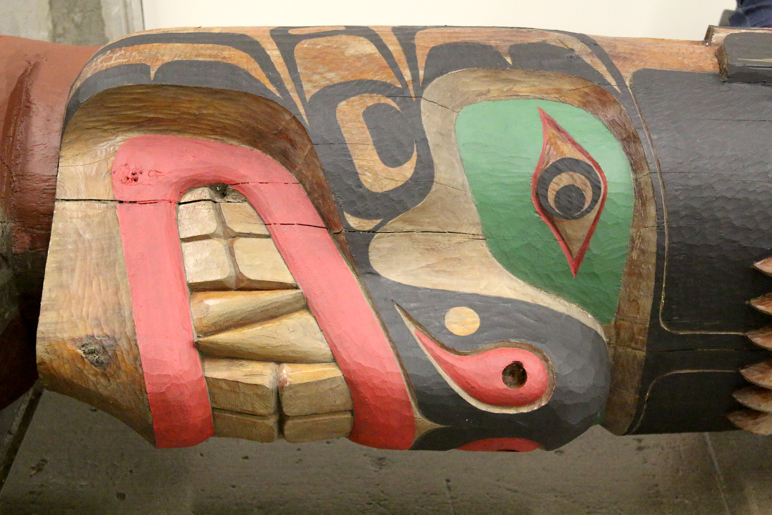 Towering carved cedar totem poles are part of the heritage of the Pacific Northwest Native tribes. They are filled with the images and myths from their world like bear, thunderbird, killer whale, and the like.
