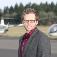 Seth Hansen at Hillsboro Airport with Robinson helicopters in the background.