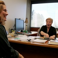 Chris Chairsell (right), vice president of academic & student affairs, shares a light moment with Kate Chester, PCC's Public Relations manager, as they discuss the college's accreditation report.