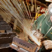 Welder working and sparks flying