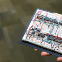 Woman's hand holding electronics project