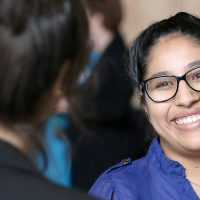 Woman of color student smiling at Day at the Capitol