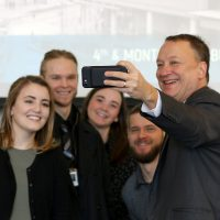 David Bangsberg, dean of joint PSU/OHSU School of Public Health, poses for a selfie with his students.