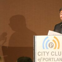 President Mitsui speaking at a podium