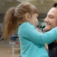 Jeff Martinez holding his daughter