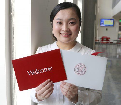 Ekubo Sawaura holds her Cornell acceptance letter.