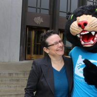 Poppiethe Panther and Lisa Avery in front of the Oregon Capitol