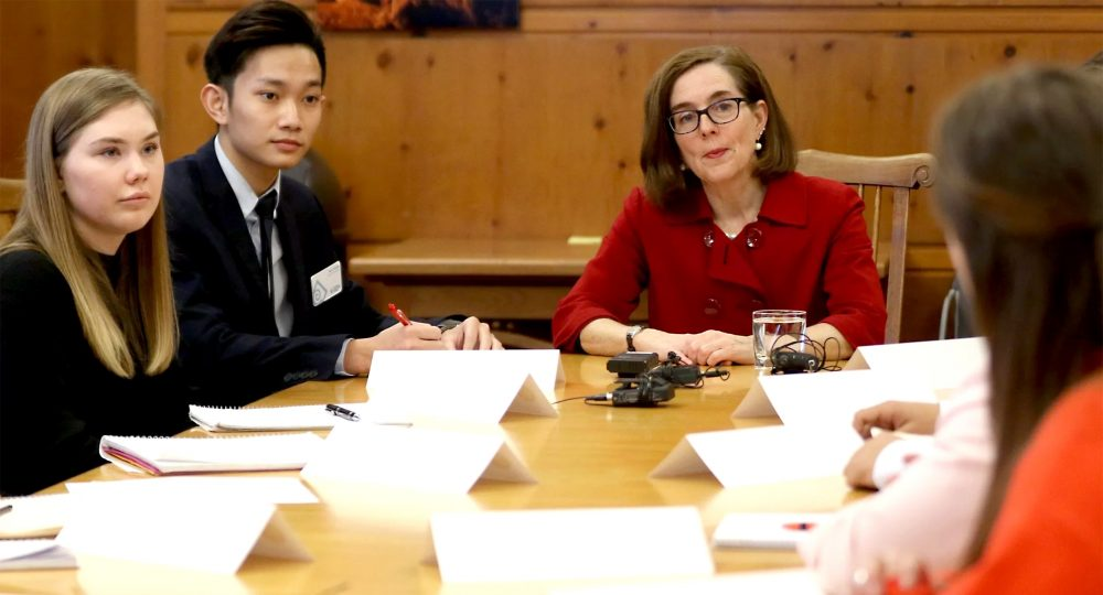 Kien Troung and Gov. Kate Brown.