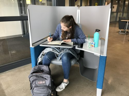 PCC Sylvania student Anna Mueller enjoys working in the study pods in CC's new Upper Mall common area. The pods feature an ergonomically designed chair, adjustable desk, and opaque screen that reduce distraction and help her stay on task.