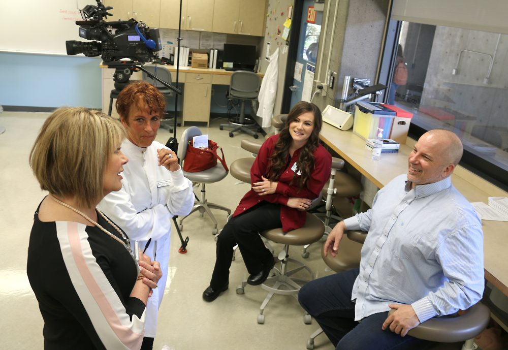 KGW anchor Tracy Barry (left) chats with Dentist Dr. April Love, PCC graduate Kayla Roxey and student Shawn Montgomery.