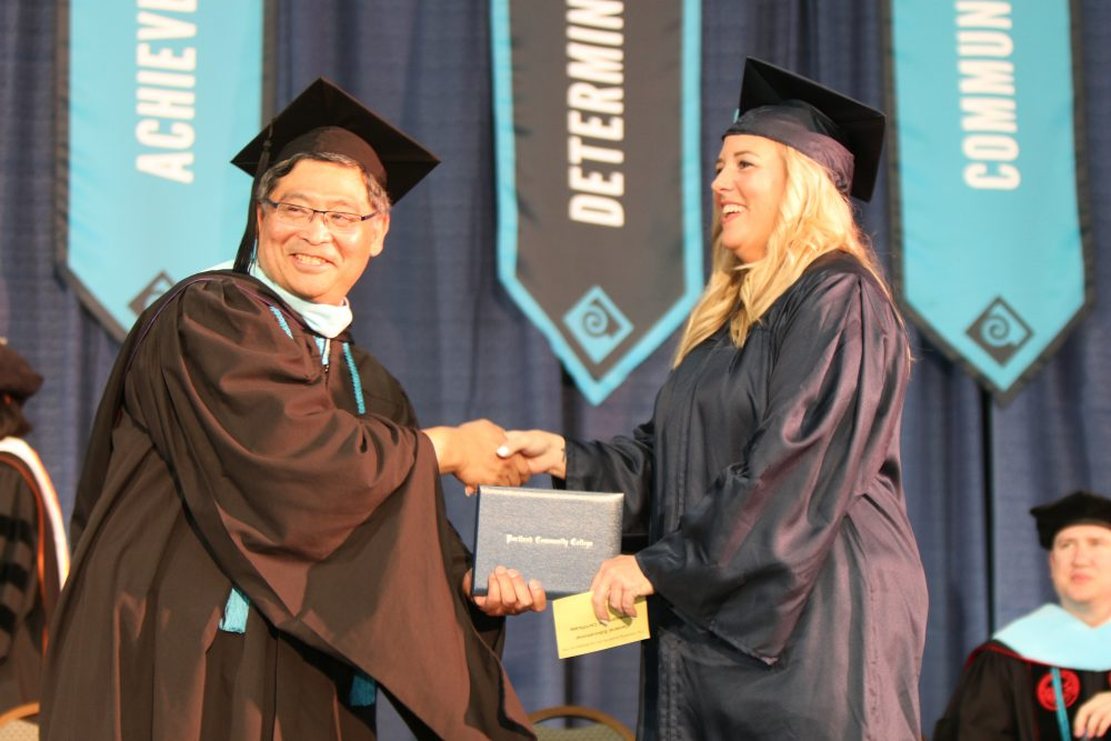 PCC President Mark Mitsui handed every graduate their degree or certificate on Friday night.