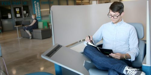 Student studying outside a resource center