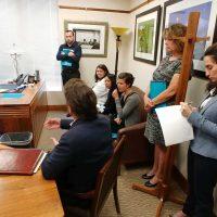Emma Kallaway takes notes at leg visit.