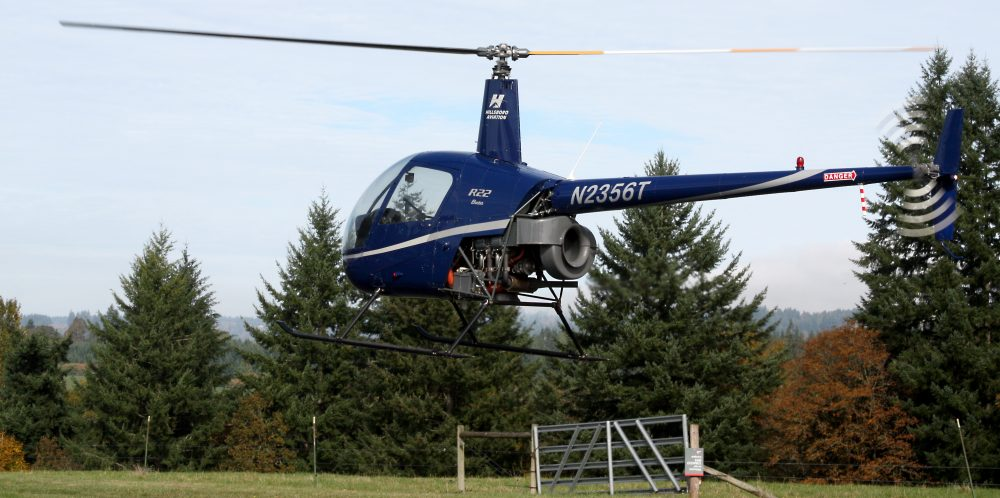 A Robinson-22 helicopter comes in for a landing at Rock Creek. This is the type of aircraft that students train on in the new flight simulation room.