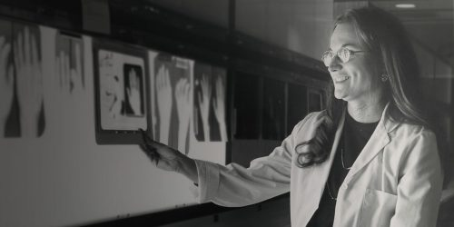 Black and white photo of student looking at x-rays