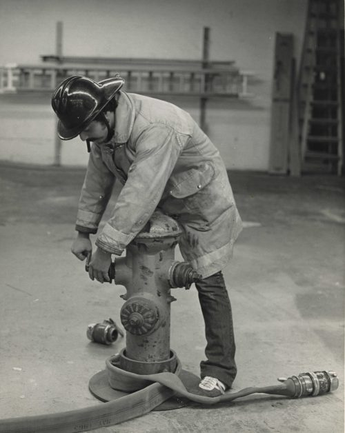 Fire Science student with hydrant.