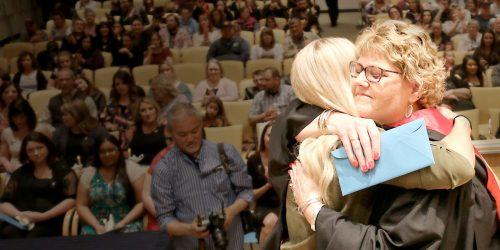 Jolie Manning hugs nursing grad.
