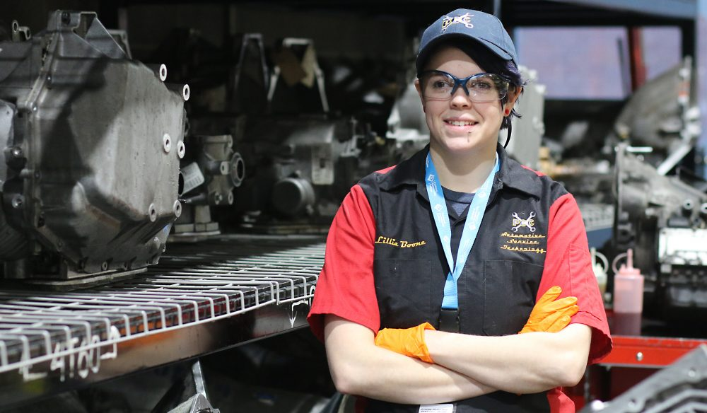 Lilly Boone poses among the shop's engines.