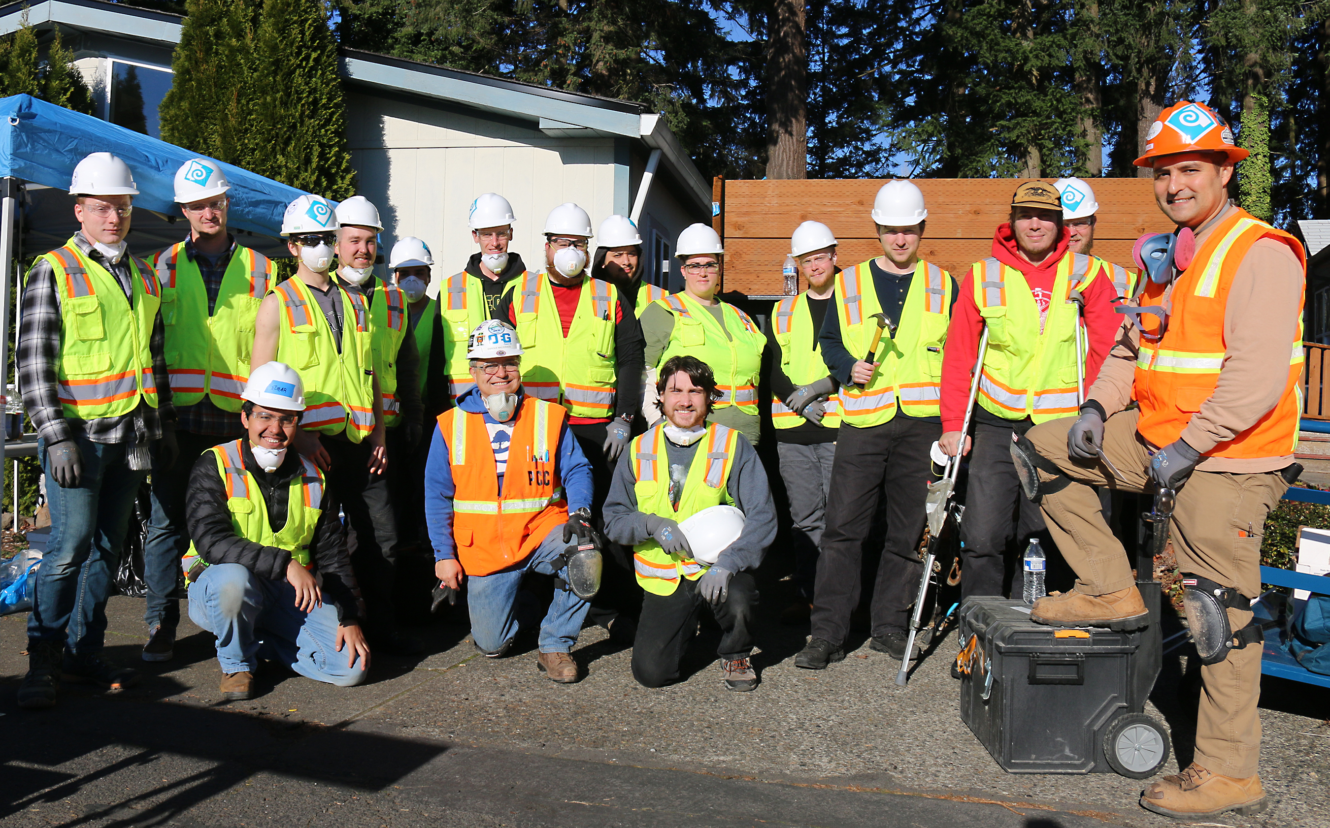 Trades class group photo in hardhats and vests