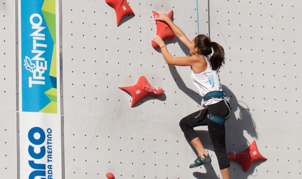 Sonja climbs wall.