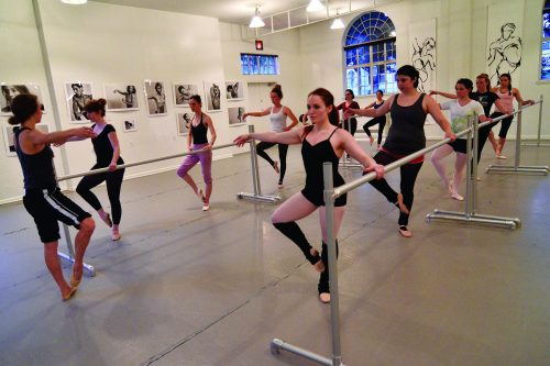 Group of dancers practice ballet