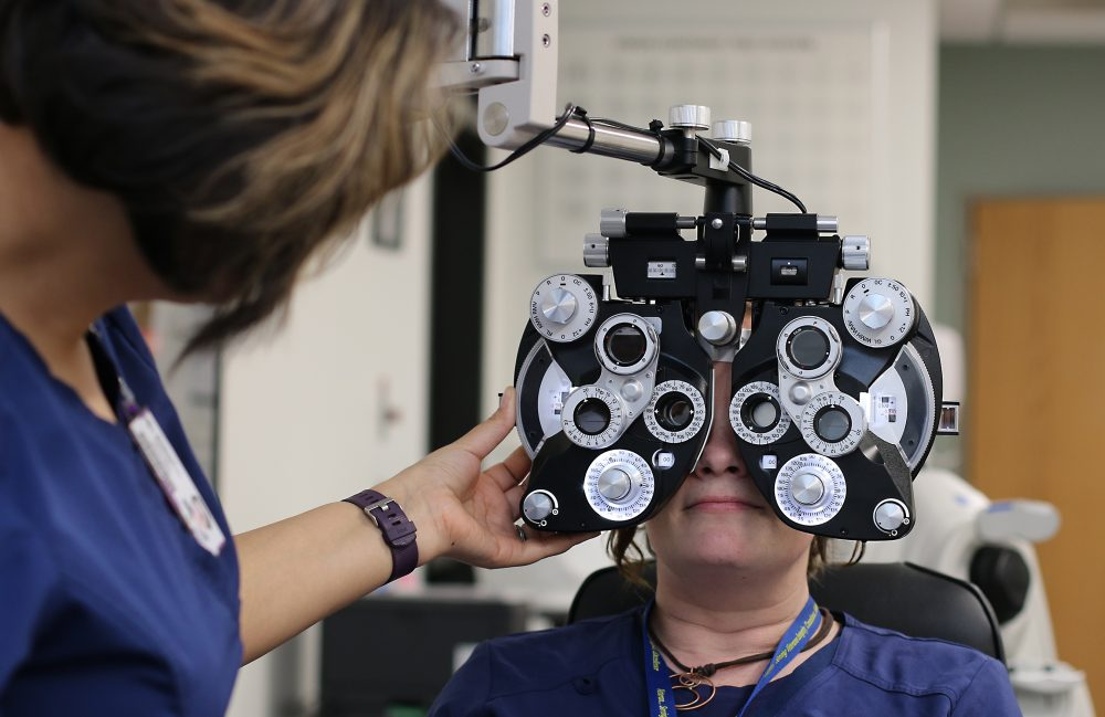 Testing a patient's eyes.