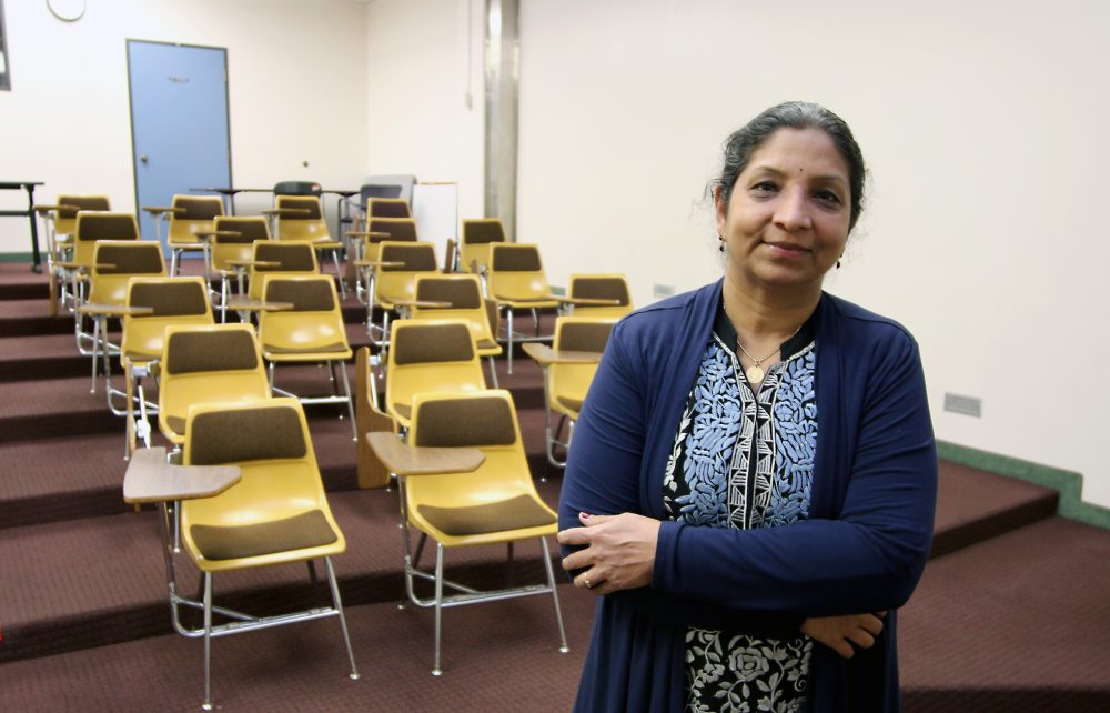 Usha in front of her classroom.
