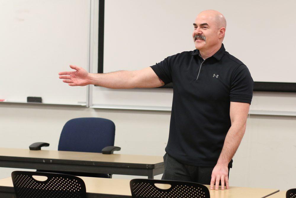 Black teaches in a PSEB classroom.