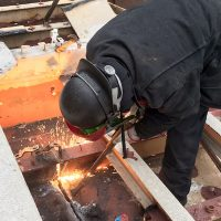 Jess welders steel together.