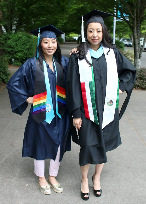 Veyda and Margarita in cap and gowns.